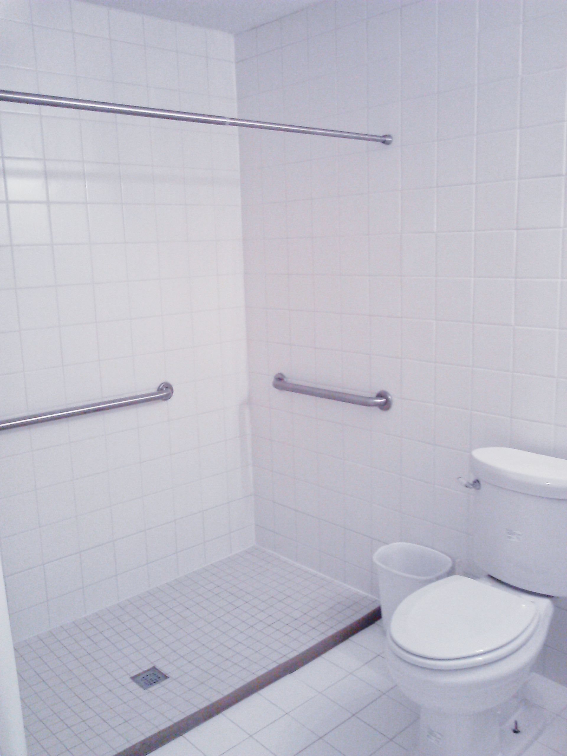 Gallery of what we do restore independence white tile wet room custom tile wetroom floor dailygadgetfo Choice Image